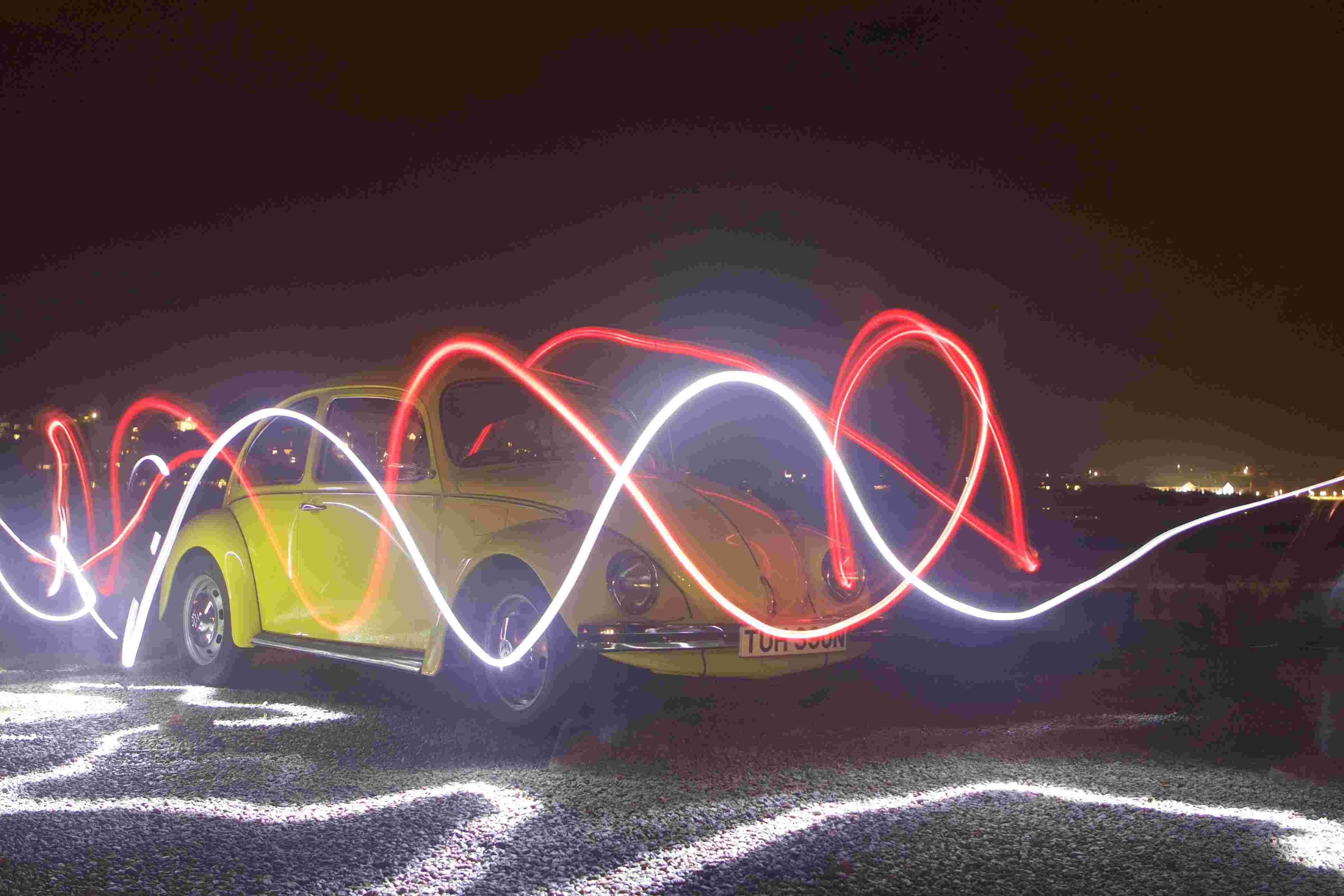 Light trails in front of Volkswagen Beetle